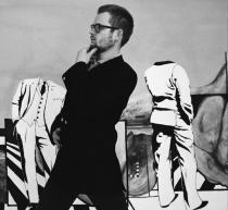"Portrait of the artist in front of his painting ""Geometer"" (1965), ca. 1967