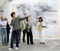 Julie Mehretu and members of the Deutsche Guggenheim Club at her studio in Berlin, May 2009